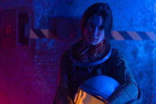 Woman in Spacesuit With Helmet