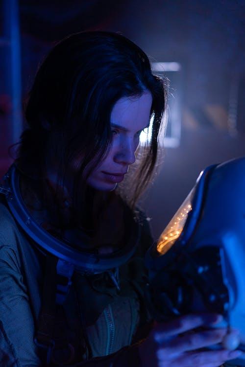 Woman in Blue Jacket Wearing Blue Headphones