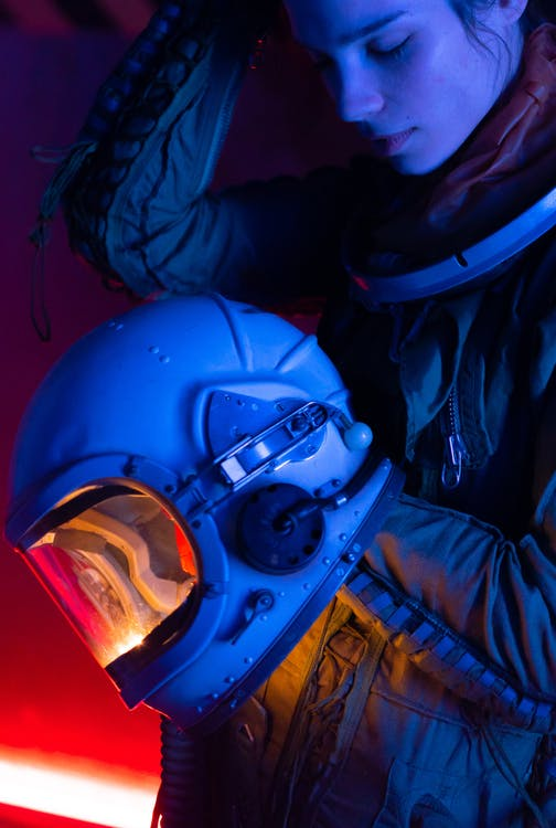 Woman Wearing A Spacesuit With Helmet