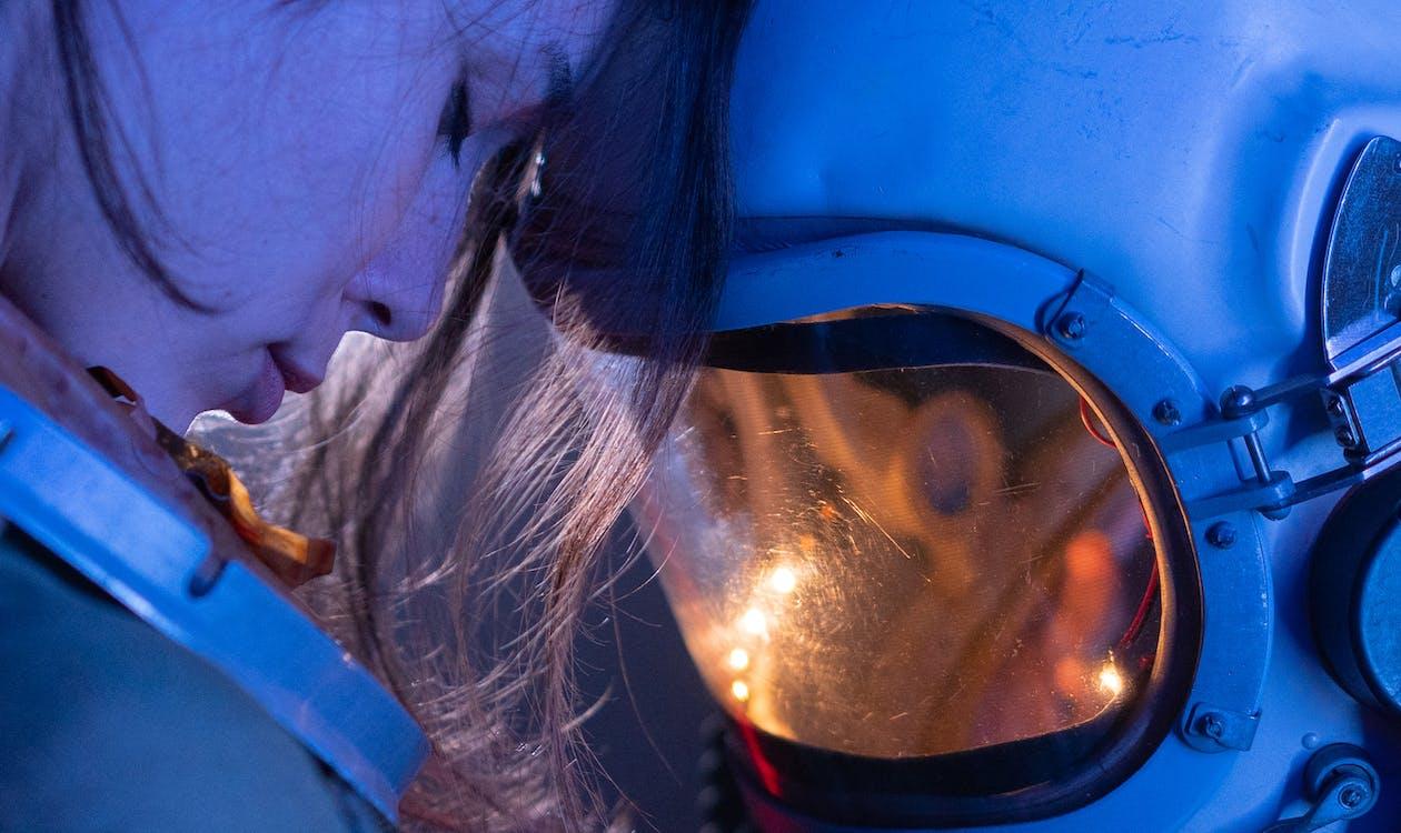 Woman in Blue Spacesuit