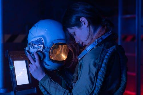 Woman in Spacesuit Looking Tired