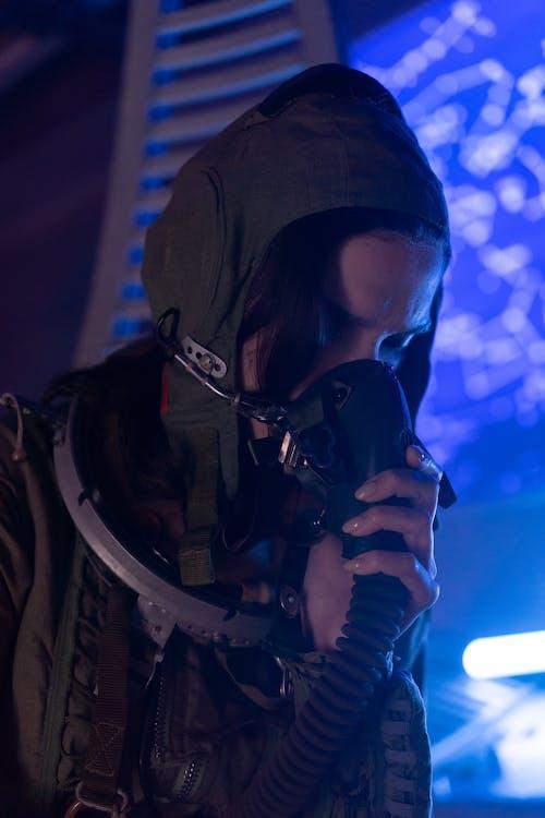 Wonman in Spacesuit Breathing Oxygen