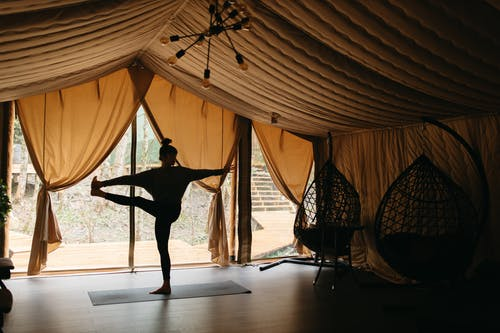 Silhouette of Woman in Activewear Doing Yoga