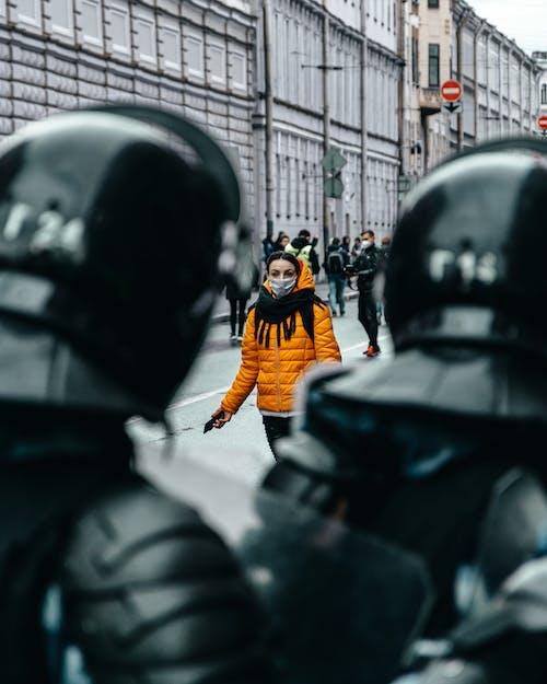 Man in Orange Jacket and Black Helmet