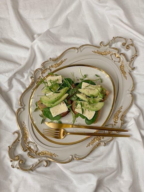 Sliced Cucumber on White Ceramic Plate