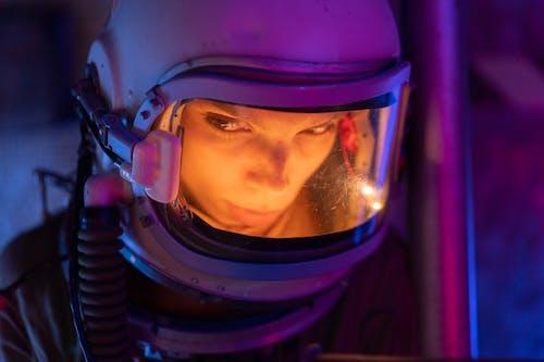 Woman Wearing a Spacesuit Looking Sideways