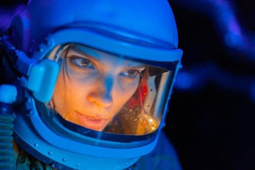 A Woman Wearing Spacesuit Costume Helmet