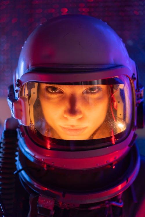 Woman Wearing Spacesuit And Helmet