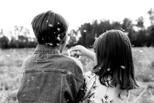 Grayscale Photo of Woman and Girl