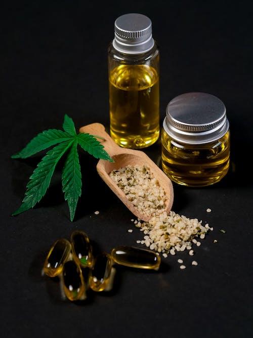 Photo of Cannabis Oil on a Clear Plastic Jar