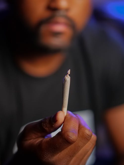 Man Holding White Cigarette Stick