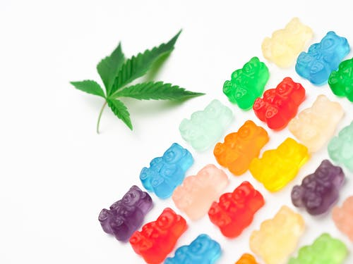Photo Assorted Colored Gummy Bears on White Background