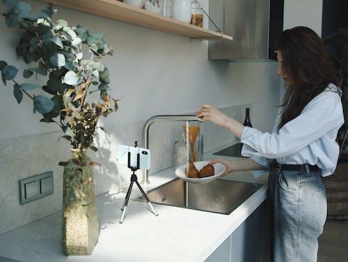 Woman Washing the Potatoes on Plate