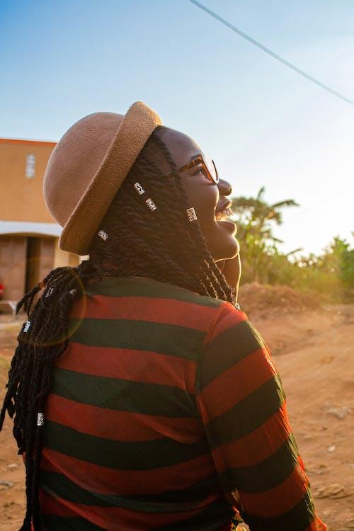 A Happy Woman Wearing a Striped Shirt