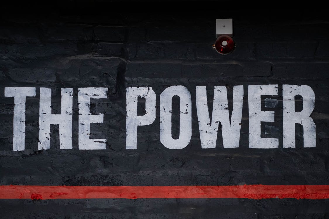The Power Text Sign on a Wall