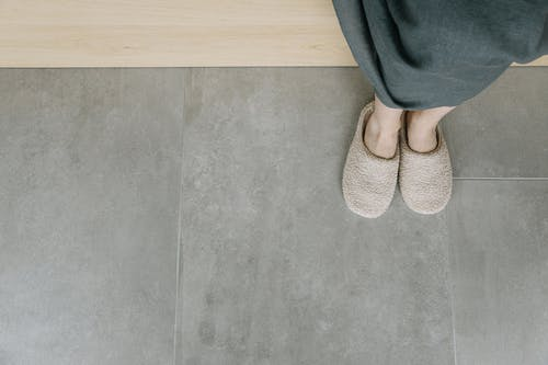 A Person Wearing an Indoor Slippers