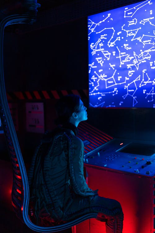 Woman Looking On A Screen Inside A Spacecraft