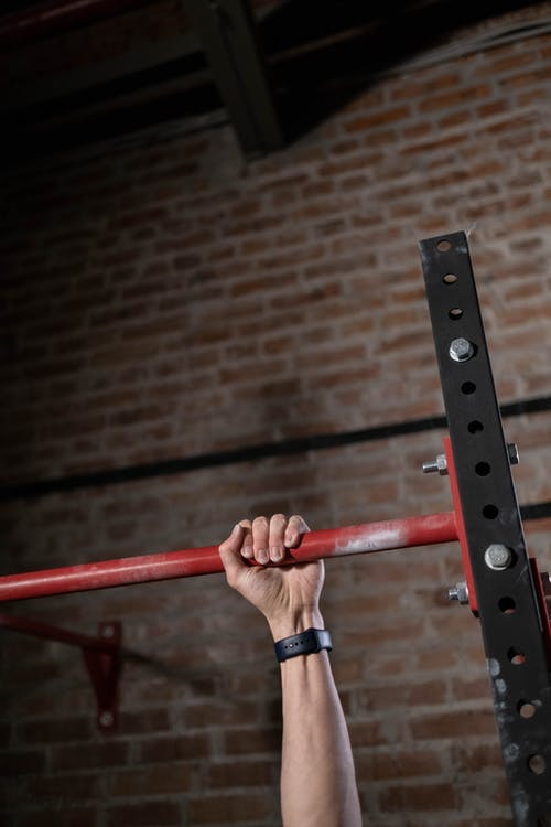 Close-Up View of a Person Doing Pull-Ups