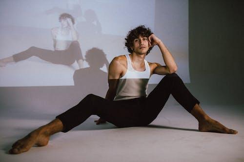 Male Dancer Sitting On Floor