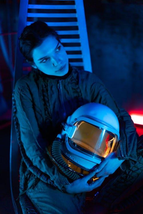 Man in Blue and Black Jacket Wearing Blue Helmet