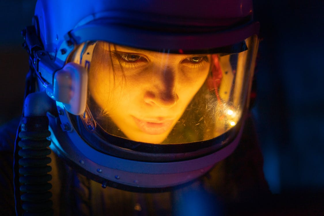 Close-up Photo Of Woman In A Spacesuit