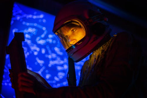 Woman In Spacesuit Looking At A Screen