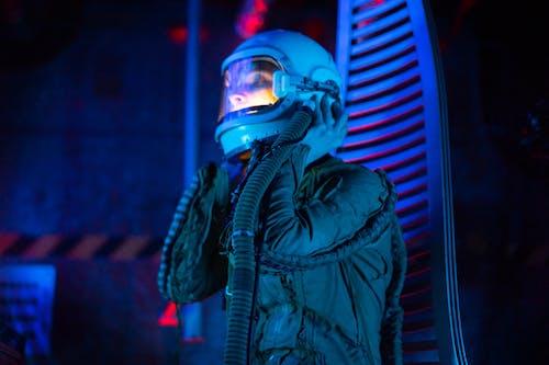 Woman In Spacesuit Holding Her Helmet