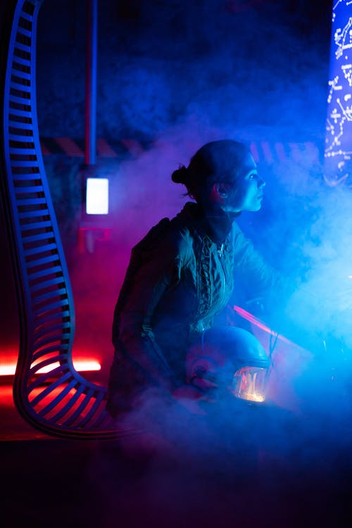 Woman Sitting Inside A Spacecraft With Smoke Around Her