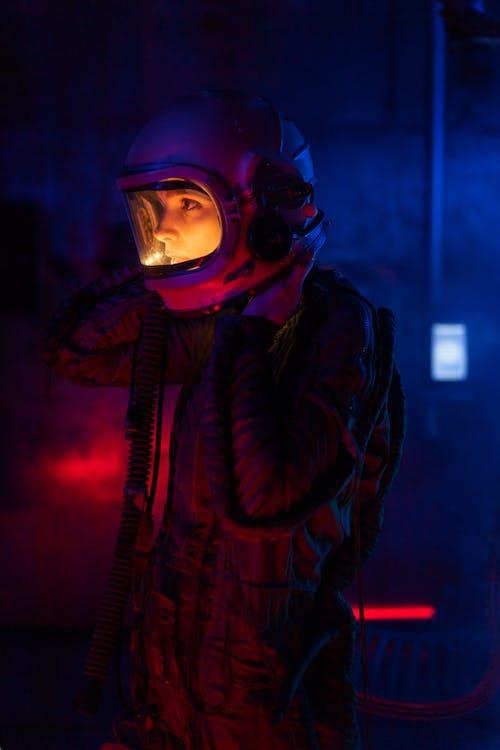 Woman In Spacesuit Looking At Something