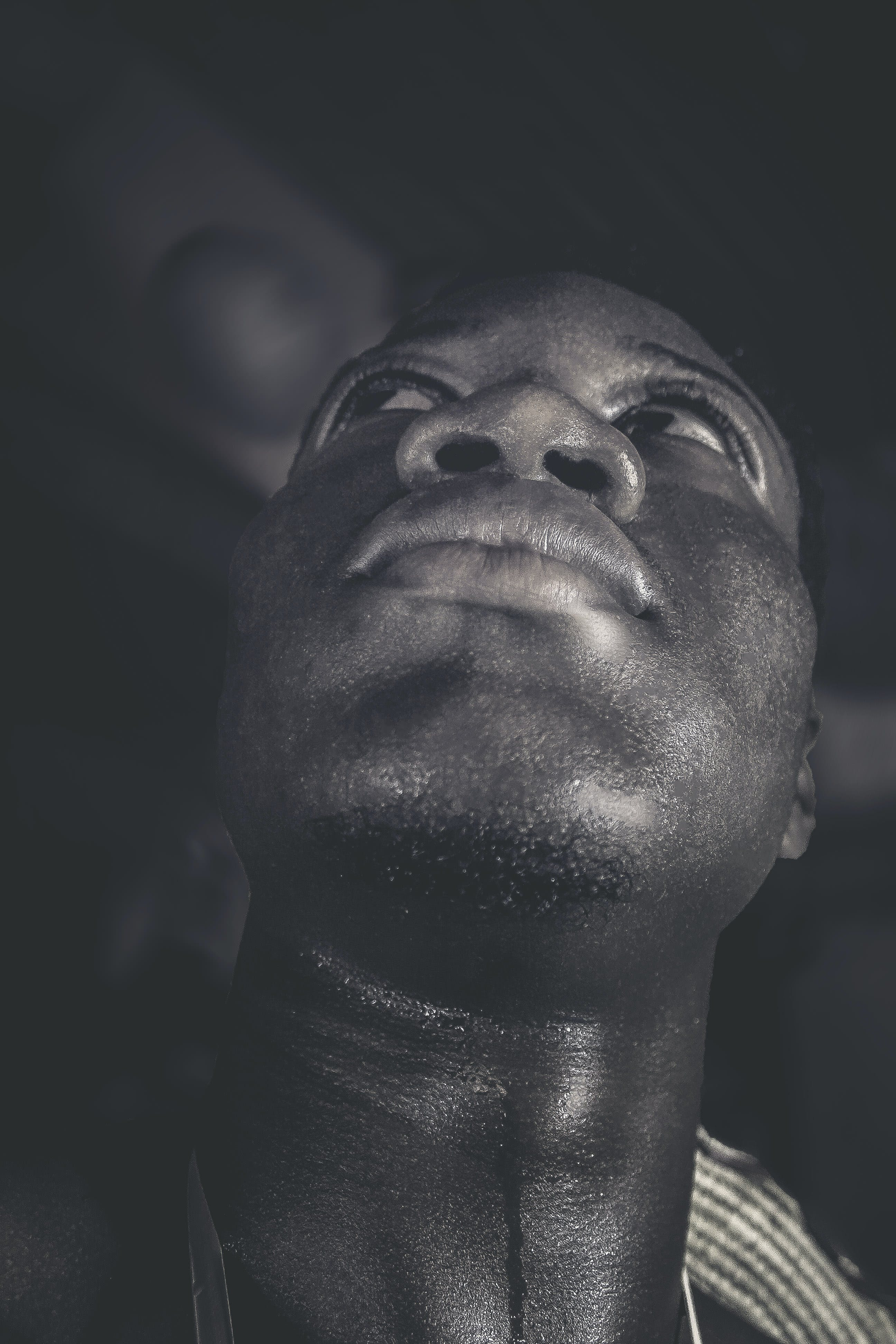 Grayscale Photo of Man Looking Up