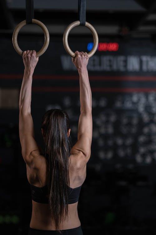 Woman in Black Tank Top Doing Yoga