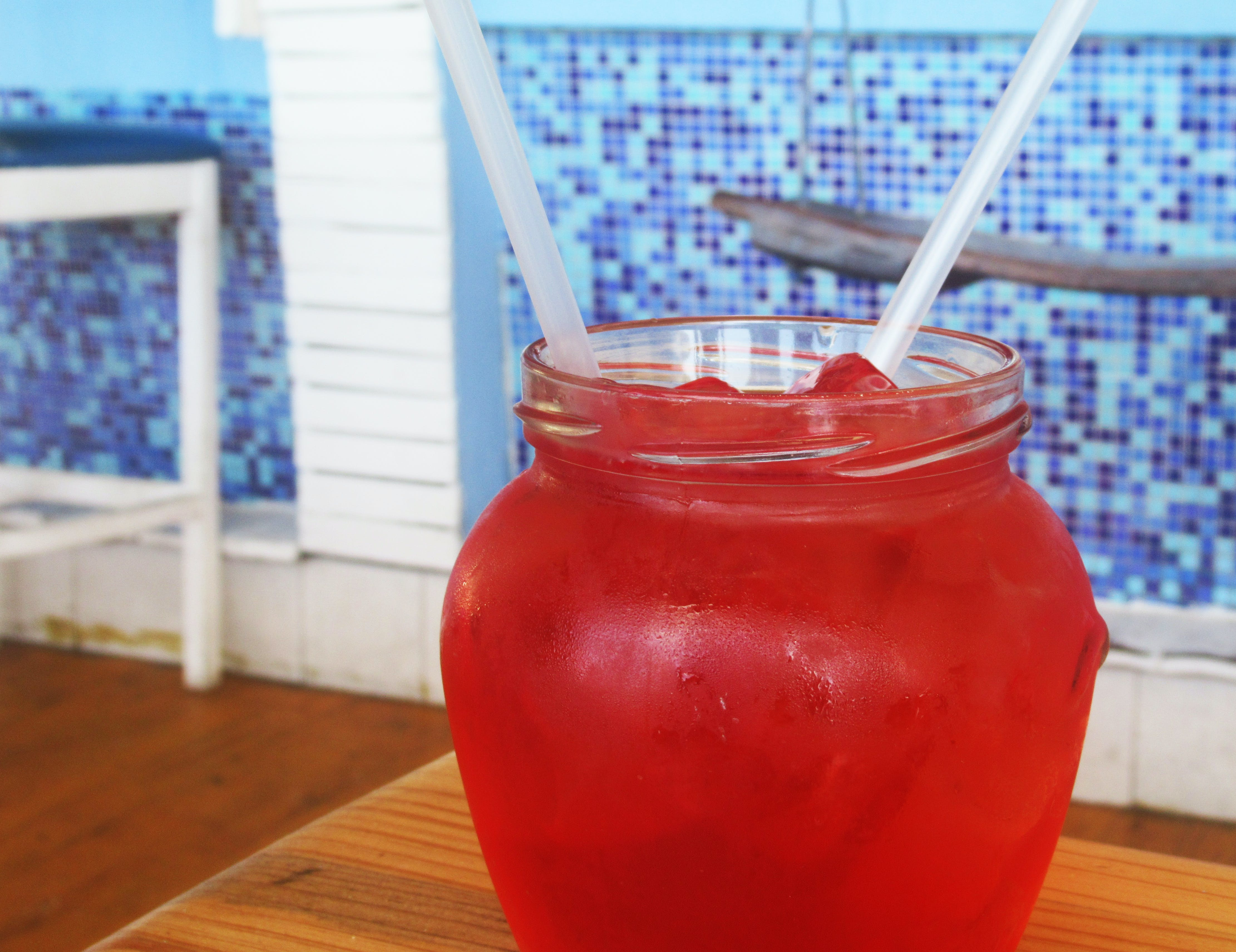 Red Beverage on Clear Glass Dispenser