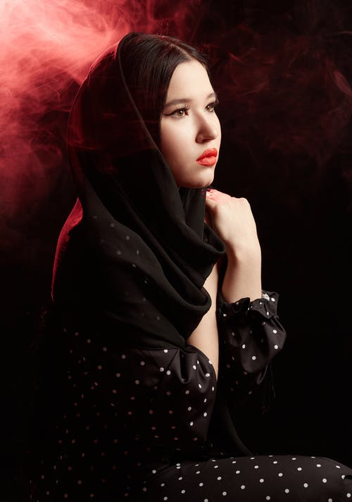 Woman in Black Hijab and Polka Dot Dress