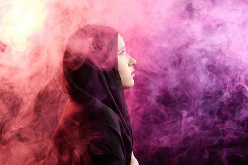 Woman in Black Hijab With Purple Hair