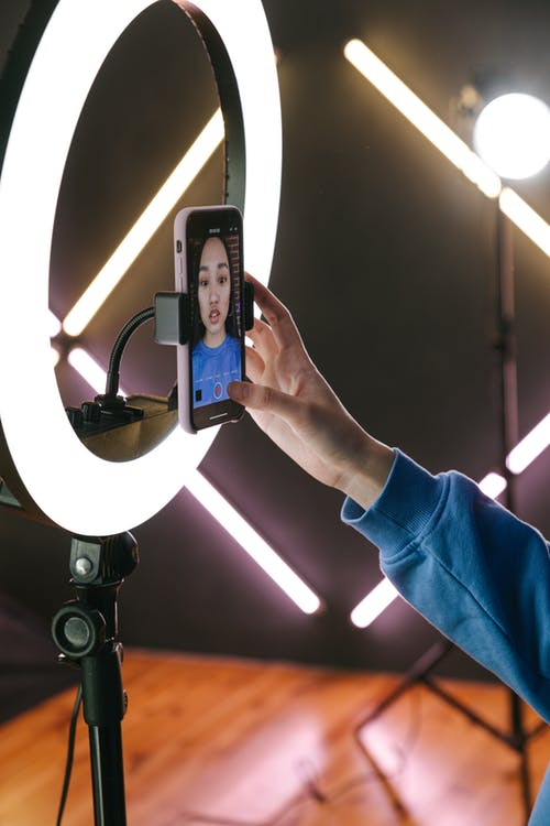 A Woman Recording Herself with a Smartphone