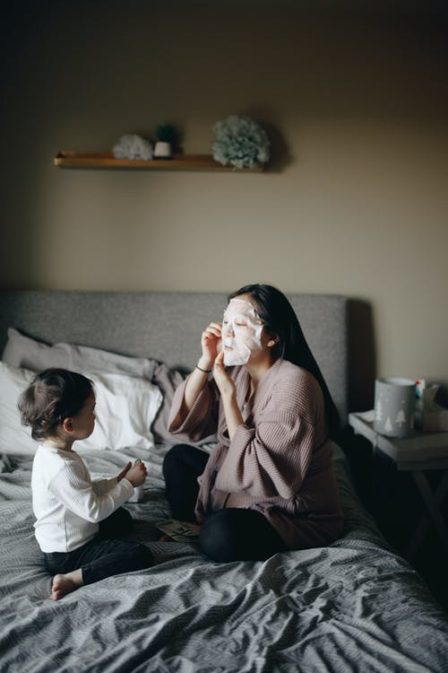 Mother Covering Her Face With Mask