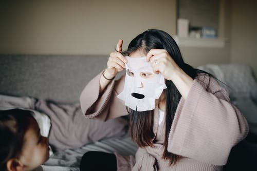 Mother Putting On A Mask