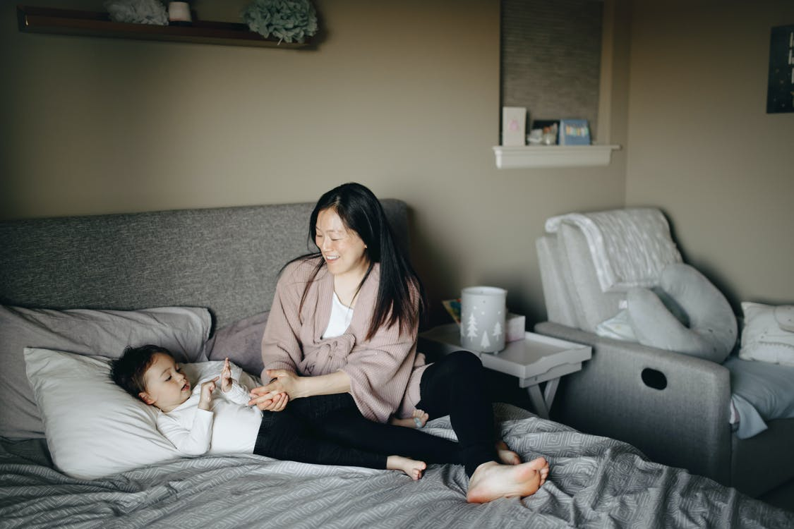 Woman Putting Her Child To Sleep