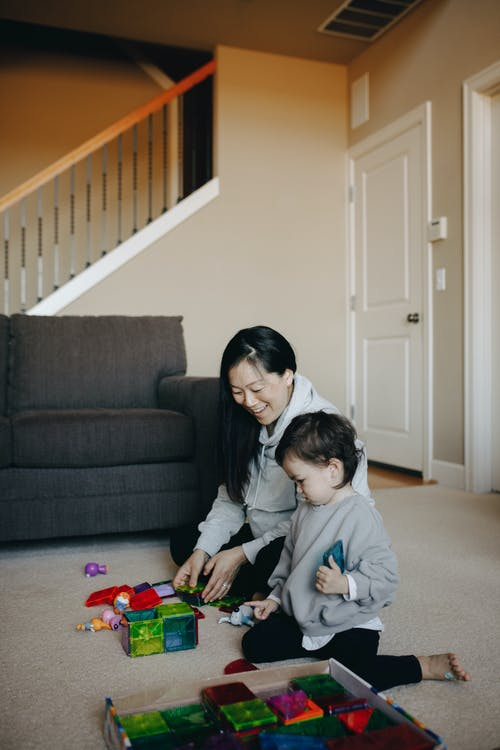 Mother And Child Playing With Toys Together