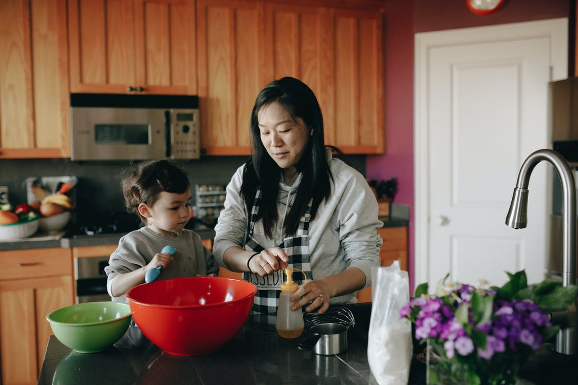 Mother And Child Baking In Kitchen