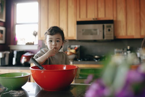 A Child Baking In The Kitchen