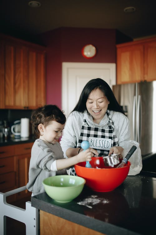 Mother and Baby Baking Together in the Kitchen