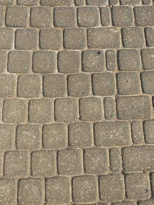 Textured road on city street in daytime