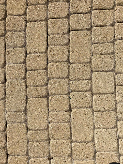 Textured background of pavement on street on sunny day