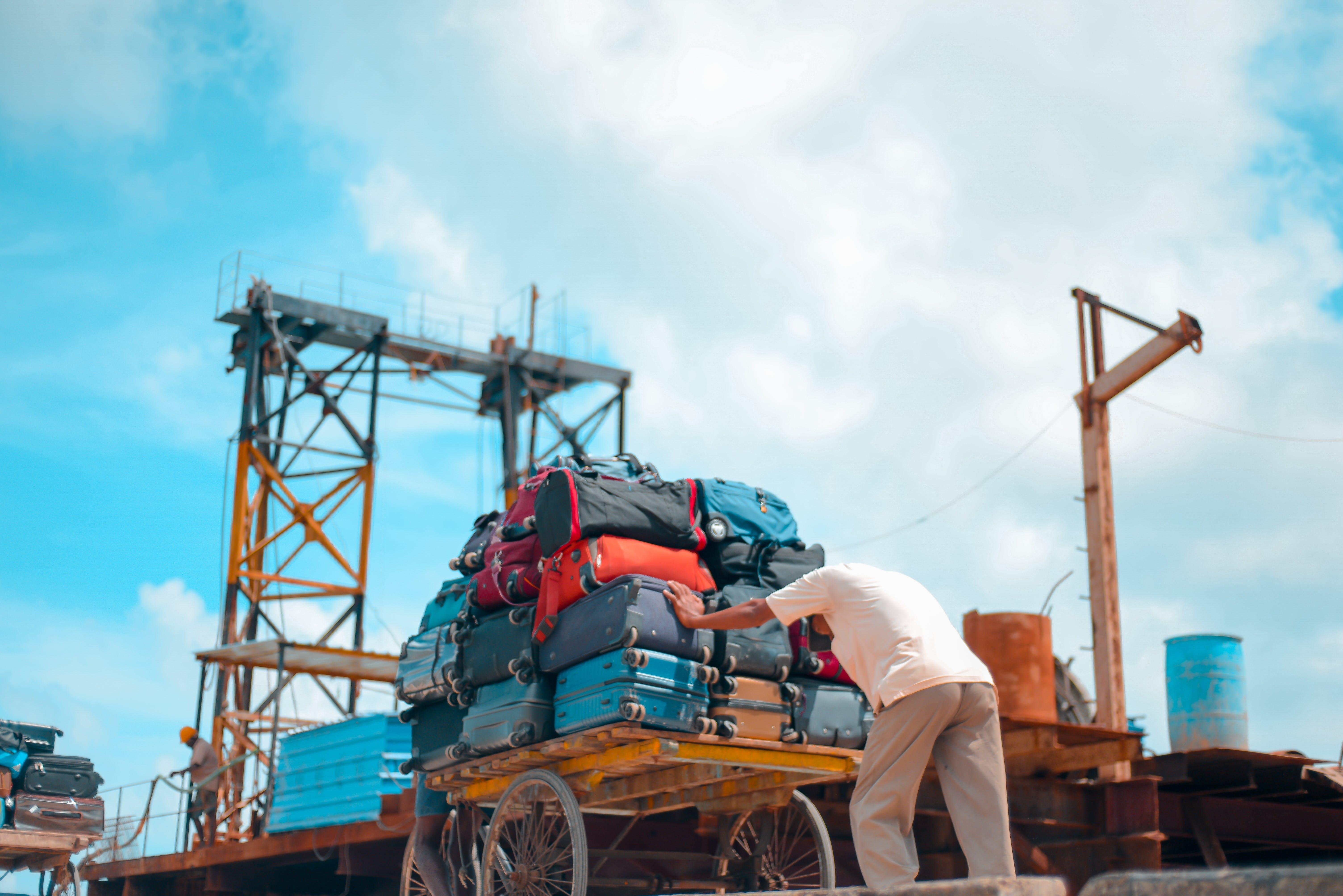 Free stock photo of cart, construction, luggage, man