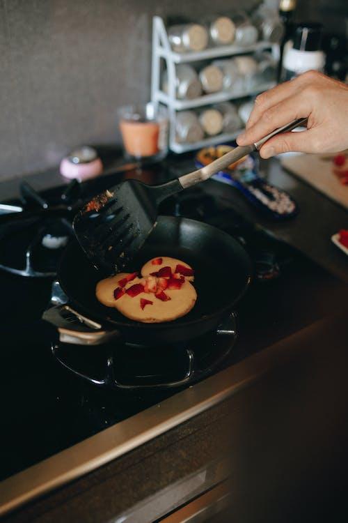 Person Cooking Pancake