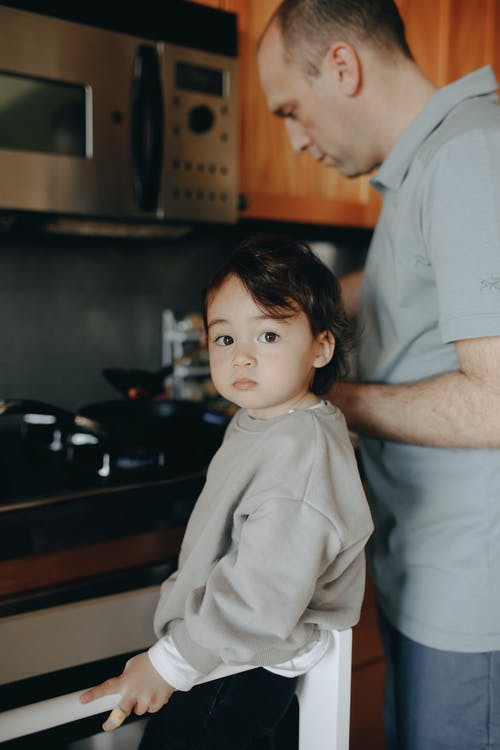 Father Cooking In The Kitchen With Her Child