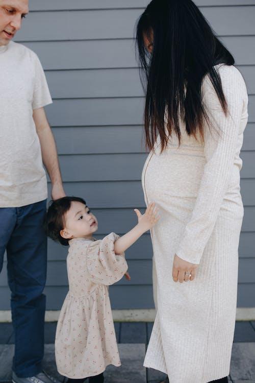 Little Girl Holding Her Mom's Tummy