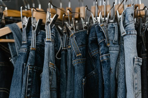 Close-Up Photo of Denim Jeans on a Clothing Rack
