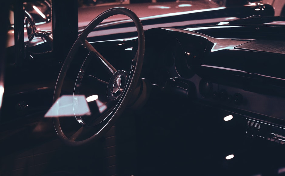 Classic Car Interior Showing Wooden Steering Wheel